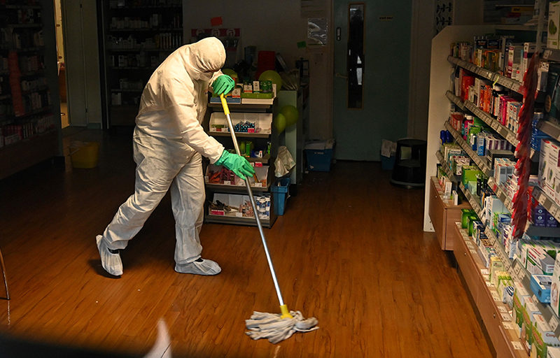 Worker Disinfecting
