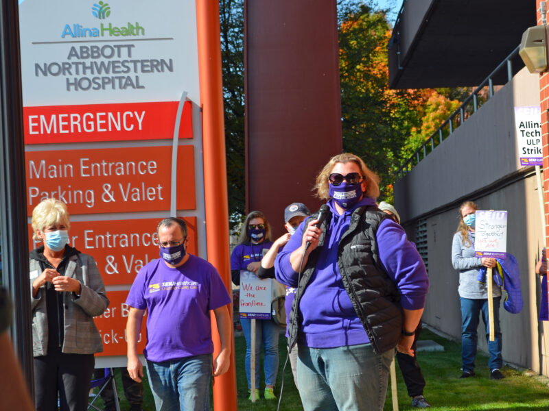 Judy Grack standing and speaking at a rally outside hospital