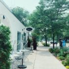 the front of birchwood cafe, including a sign on the top left, metal chairs stacked up on the left