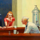 a segment of Nighthawks by Edward Hopper, an artwork that shows a man in a blue suit and grey fedora sitting next to a redheaded woman in a red dress being served at a bar by a man in a white hat and coat